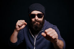 Handsome male big beard in glasses and hat Stock Photography