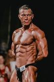 Handsome male bodybuilder straining press Royalty Free Stock Image