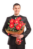 Handsome male with a bouquet of flowers Stock Photography