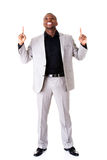 Handsome male businessman pointing up with fingers. Stock Image