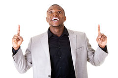 Handsome male businessman pointing up with fingers. Royalty Free Stock Photo