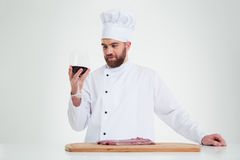 Handsome male chef cook degusting wine Royalty Free Stock Images