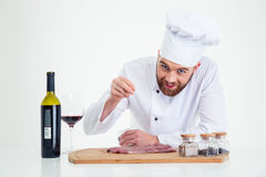 Handsome male chef cook preparing meat Royalty Free Stock Photo