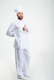 Handsome male chef cook showing thumb up sign Stock Photos