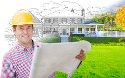 Handsome Male Contractor Wearing Hard Hat In Front of House Drawing Grada. Male Contractor Wearing Hard Hat In Front of House Drawing Gradation Into Photograph Royalty Free Stock Photography