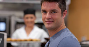 Handsome male customer in a bakery Stock Photos