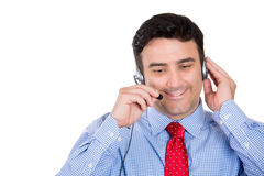 Handsome male customer service representative or operator or help desk support staff wearing a head set Royalty Free Stock Photography