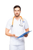 Handsome male doctor with clipboard isolated Royalty Free Stock Photo