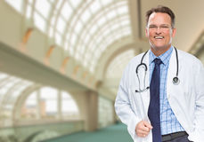 Handsome Male Doctor or Nurse Inside Hospital Building. Handsome Male Doctor or Nurse Standing Inside Hospital Building Royalty Free Stock Photo