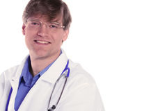 Handsome male doctor smiling. With stethoscope draped around neck. Friendly expression Stock Photo
