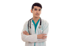 Handsome male doctor in uniform with stethoscope posing isolated on white background. Handsome male doctor in uniform with stethoscope posing isolated on white Royalty Free Stock Image