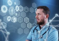 Handsome male doctor and virtual computer interface. Innovative technologies in science and medicine. Handsome male doctor and virtual computer interface Stock Image