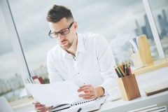 Handsome male with document Stock Image