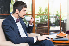 Handsome male drinking a cup of espresso coffee Royalty Free Stock Images