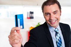 Handsome male executive holding cash card Stock Image