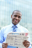 Handsome male executive reading a newspaper Royalty Free Stock Photo