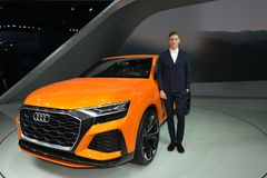 A Handsome Male Fashion Model on Audi Q8 hybrid concept SUV Stock Photography