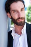 Handsome male fashion model with beard posing outdoors Stock Photo