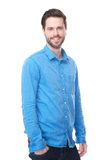 Handsome male fashion model in blue jeans and shirt Royalty Free Stock Photography