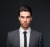 Handsome male fashion model in business suit. Close up portrait of a handsome male fashion model in business suit Royalty Free Stock Photo