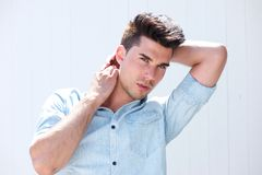 Handsome male fashion model with hands in hair Stock Photo
