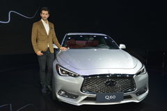 A Handsome Male Fashion Model on Infiniti Q60 saloon Stock Photos
