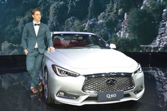 A Handsome Male Fashion Model on Infiniti Q60 saloon Stock Images