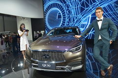 A Handsome Male Fashion Model on Infiniti QX30 SUV Stock Photography