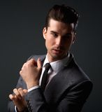 Handsome male fashion model posing in business suit stock photo