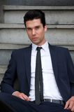 Handsome male fashion model posing outdoors Royalty Free Stock Photography