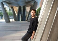 Handsome male fashion model standing outdoors Stock Images