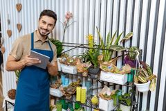 Florist with digital tablet Royalty Free Stock Image