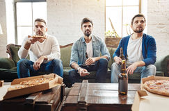 Handsome male friends resting at home Stock Photo