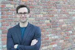 Handsome male with glasses portrait with arms crossed Stock Photography
