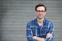 Handsome male with glasses portrait crossing his arms with copy space Royalty Free Stock Photography