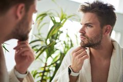 Handsome male going to shave after sleep stock photography