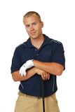 Handsome male golfer. A handsome male golfer with his hands on his club Royalty Free Stock Photo