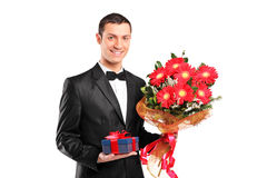 Handsome male holding a bouquet of flowers Stock Image