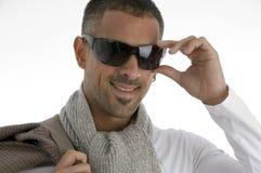 Handsome male holding eyewear Stock Photography