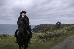 Handsome Male Horse Rider Regency 18th Century Poldark Costume with tin mine ruins and Atlantic ocean in background Stock Photos