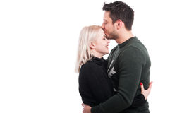 Handsome male kissing his girlfiend on forehead Royalty Free Stock Images