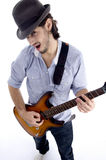 Handsome male looking at camera and playing guitar. On an isolated white background Royalty Free Stock Photography