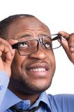 Handsome male looking through his glasses. Royalty Free Stock Images