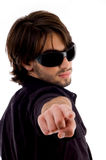 Handsome male looking and pointing backward Stock Image