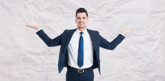 Handsome male manager with palms up Stock Photos