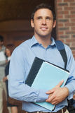 Handsome male mature student posing holding some files. In the corridor Royalty Free Stock Images