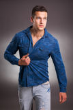 Handsome male model on gray background Royalty Free Stock Photos