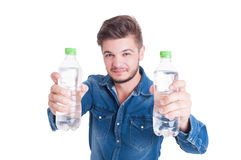 Handsome male model holding two bottles of cold water Stock Images
