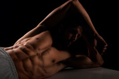 Handsome male model lying on bench Royalty Free Stock Photos