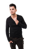 Handsome male model pulling his sweater Stock Image